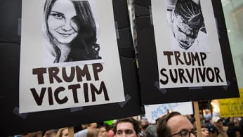 Heather Heyer and Deandre Harris posters at an anti-Trump demonstration outside of Trump Tower