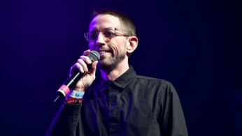 Comedian/actor Neal Brennan performs onstage at The Fonda Theatre