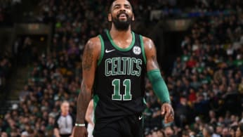 Kyrie Irving laughs on the court.