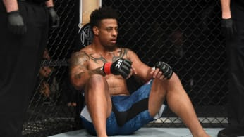 Greg Hardy sits in his corner after being disqualified