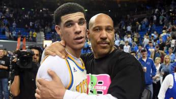 LaVar Ball hugs his son Lonzo.