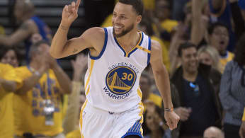 Steph Curry acknowledges teammate on the court.