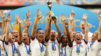 Carli Lloyd of the USA lifts the FIFA Women's World Cup Trophy