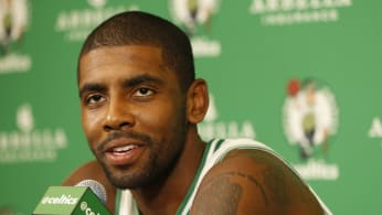 Kyrie Irving talks to the media during media day.