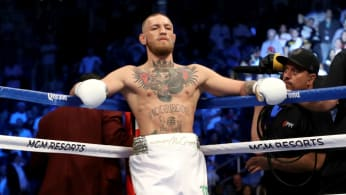 Conor McGregor stands in his corner during his super welterweight boxing match