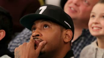Former New York Knicks Carmelo Anthony attends the game