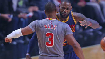 Dwyane Wade and LeBron James embrace during a Bulls-Cavs game.