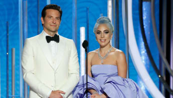 Presenters Bradley Cooper and Lady Gaga speak onstage
