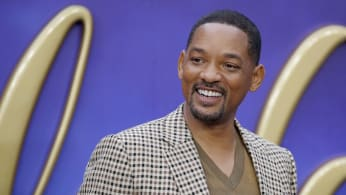 "Will Smith poses on arrival for the European Gala of ""Aladdin."""