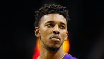Nick Young looks on as Twitter reminds him of how he used to slander Warriors fans.