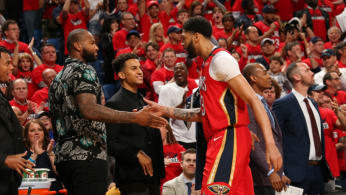 Anthony Davis #23 of the New Orleans Pelicans high-fives DeMarcus Cousins #0