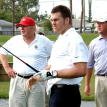 Tom Brady tees off watched by Donald Trump