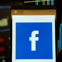 The logo of Facebook is seen in a smartphone
