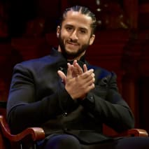 Colin Kaepernick on stage at the W.E.B. Du Bois Medal Award Ceremony at Harvard University.