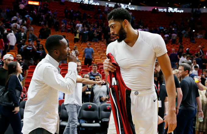 Anthony Davis #23 of the New Orleans Pelicans (left) talks with his agent Rich Paul
