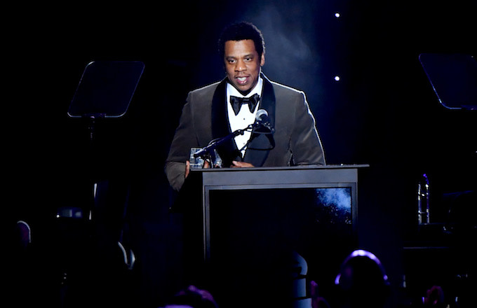 Jay-Z accepts the President's Merit Award onstage.