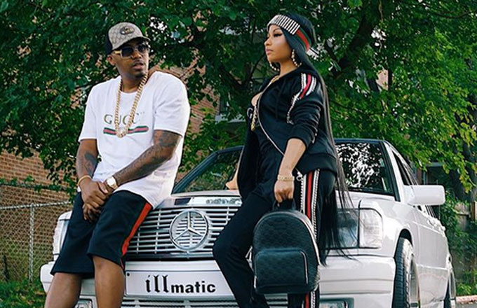 Nicki Minaj and Nas pose in front of an 'illmatic' Mercedes for Instagram.