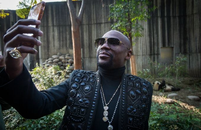 Floyd Mayweather adopts a panda in China.