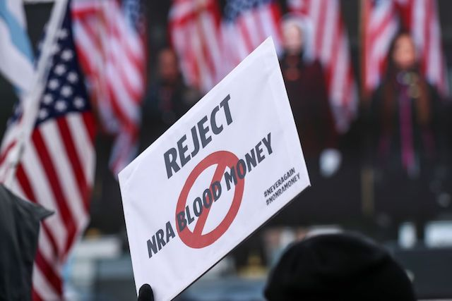 This is a picture of an anti-NRA sign.