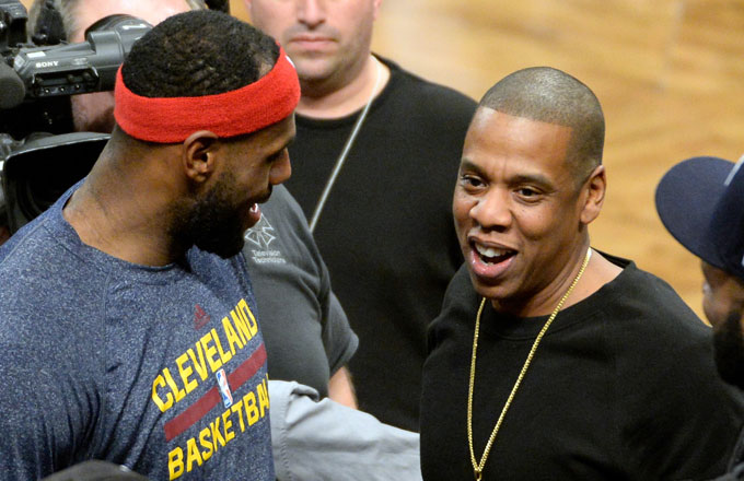 LeBron James talking to Jay Z.