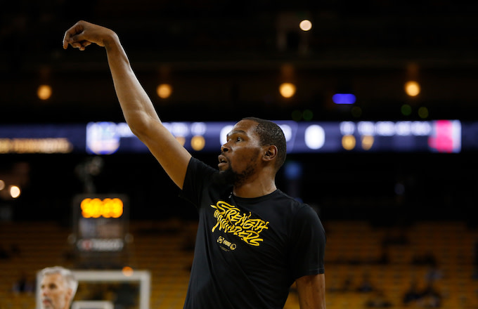 Kevin Durant warms up before Game Five of the Western Conference Semifinals.