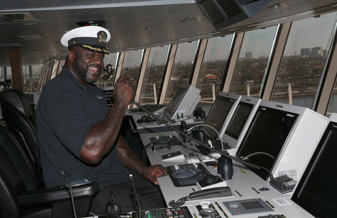 Shaq helms a boat