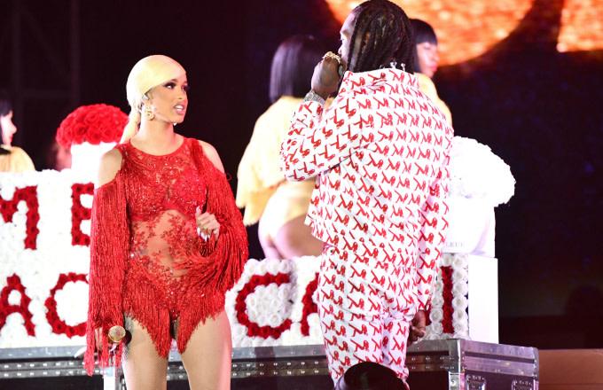 Singer Cardi B is presented a 'Take Me Back' card