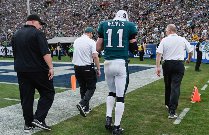 Carson Wentz walks off the field with a suspected torn ACL.