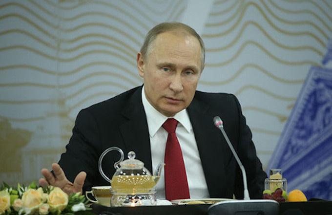 Putin addresses reporters.