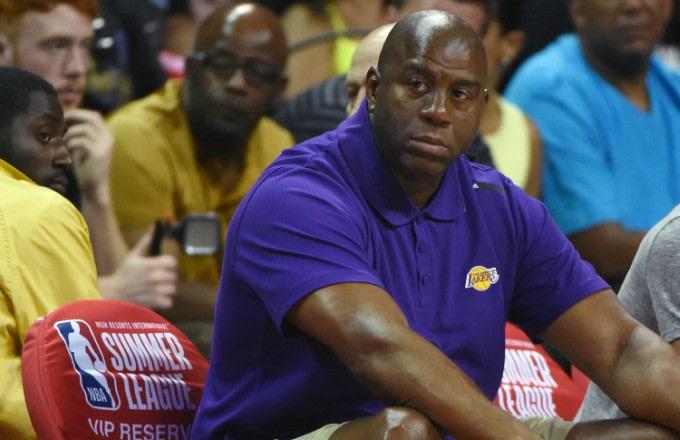 Magic Johnson watches the Lakers at NBA Summer League.