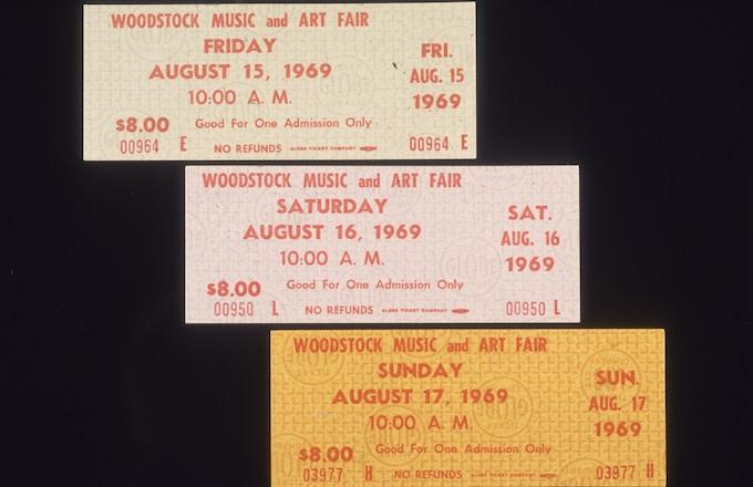 Closeup still life of three single-day admission tickets