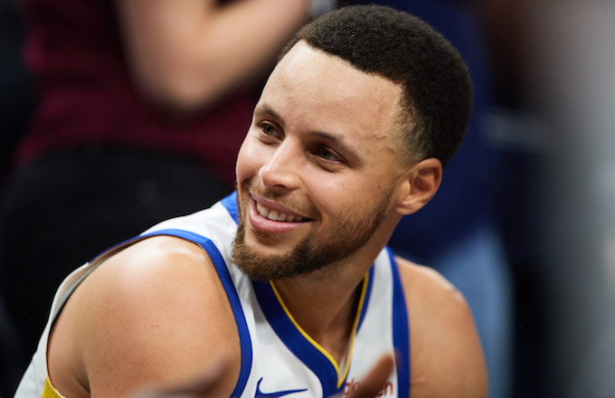 Stephen Curry looks on during game against the Minnesota Timberwolves.