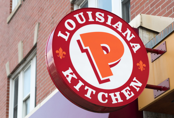 Popeyes Lousiana Kitchen sing or logo outside a restaurant wall.