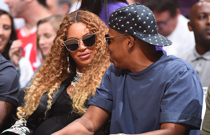 Singer, Beyonce and Rapper, Jay Z attend Game Seven of the Western Conference Quarterfinals