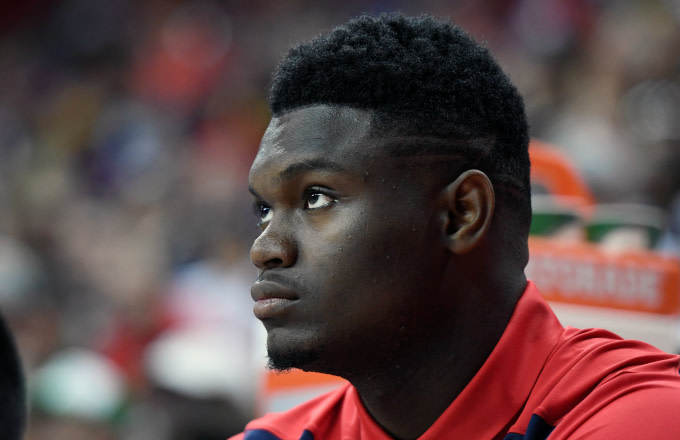 Zion Williamson #1 of the New Orleans Pelicans looks on from the bench