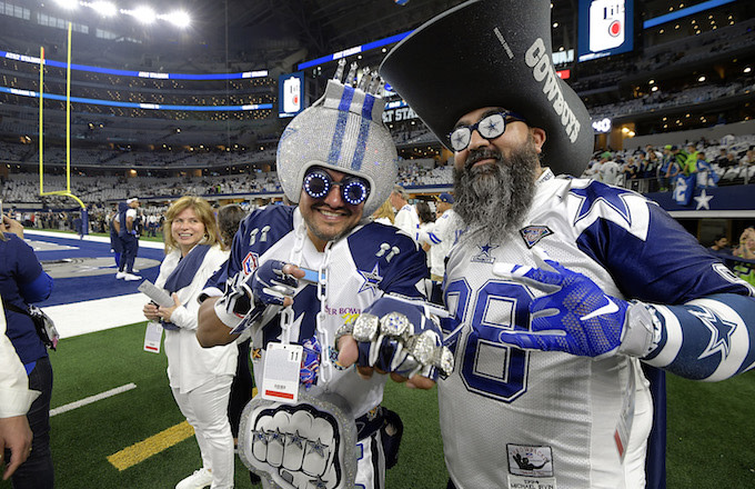 Dallas Cowboys fans on the field before action against the Seattle Seahawks.