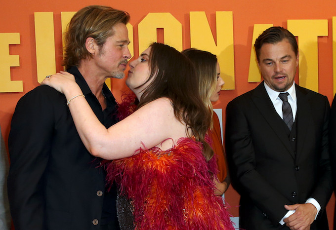 Lena Dunham trying to kiss Brad Pitt