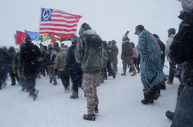 Hundreds of United States military veterans vow to defend the Standing Rock protest camp