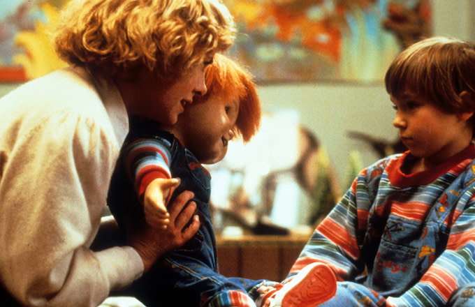 Actress Catherine Hicks and child actor Alex Vincent with Chucky