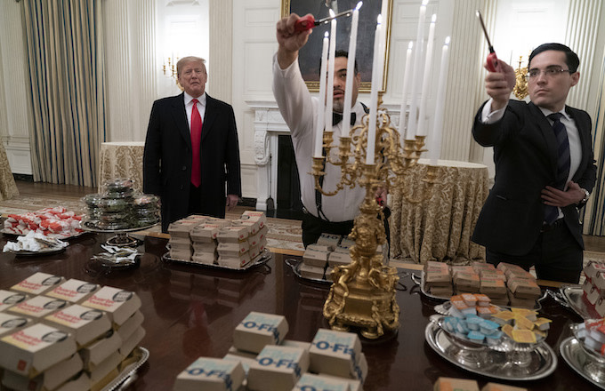 President Donald Trump presents fast food to be served to the Clemson Tigers.