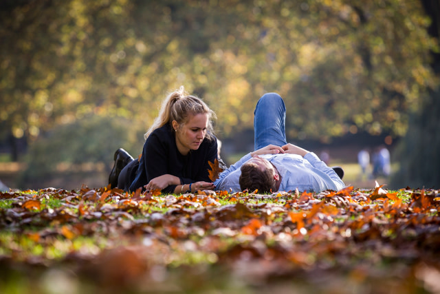 A couple relaxing in St James Park on October 31, 2014 in London, England