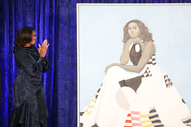 Michelle Obama with her portrait at the Smithsonian's National Portrait Gallery.