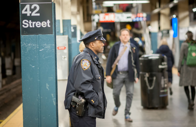 An NYPD officer on his post in the New York subway