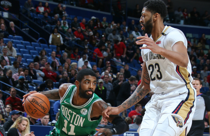 Kyrie Irving #11 of the Boston Celtics handles the ball against Anthony Davis