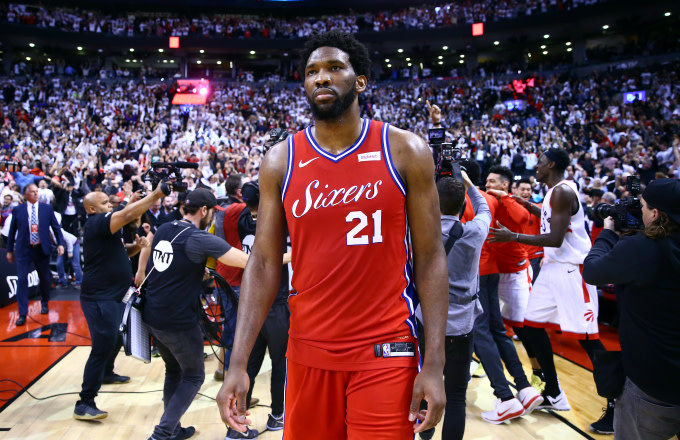 Joel Embiid #21 of the Philadelphia 76ers looks on