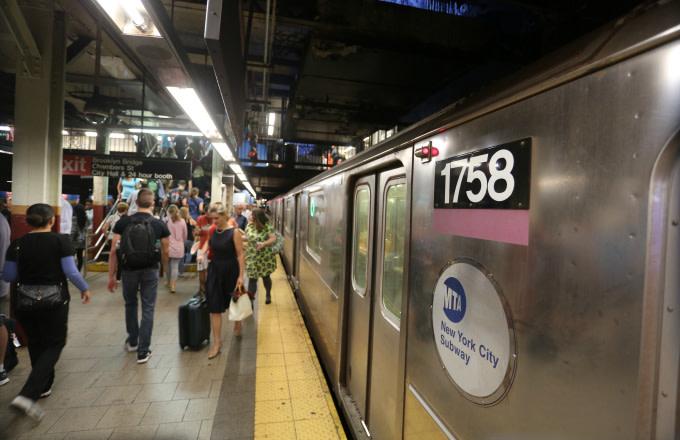People inside of the Brooklyn Bridge-City Hall subway station
