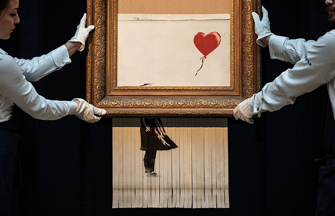 This is a photo of Banksy.