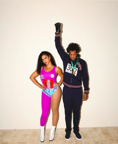 Beyoncé (L) and JAY Z (R) dressed as Florence Griffith-Joyner and Tommie Smith for Halloween