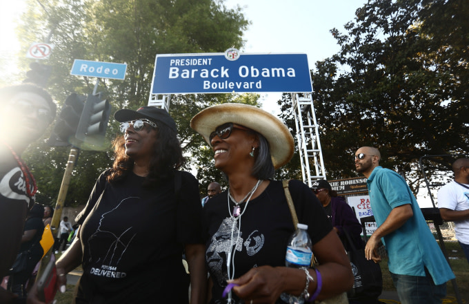 People gather at a festival where a South Los Angeles street was renamed Obama Blvd.