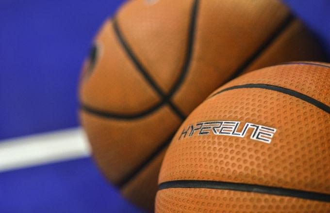 Basketballs on court.